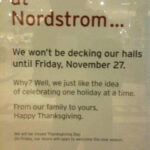 Photo of a Nordstrom Holidays store sign explaining that Nordtrom pays respect to Thanksgiving by holding off displaying Holiday decoration until November 27th.